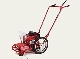 Model STP6 walk behind engine powered string trimmer with Tilt Trim Feature.