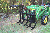Model 333000 tractor loader mount or skid steer loader mounted brush grapple. Mounting bracket required, see our index. For small and medium sized tractors and skid loaders.