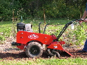 RT1350IC Mackissic Merry Tiller Rear Tine Roto-Tiller with 13.5 hp Briggs and Stratton I/C engine with recoil start. Tiller has a 21 inch tilling width, maximum 10 inch tilling depth, uses slasher style tines.