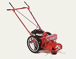 Model SST6SP walk behind string trimmer, self-propelled, powered by an 8.25 hp Briggs engine with recoil start.