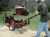 Model CPSC1350ICMC walk behind stump grinder with front/rear mount cutting head. Has 13 HP Briggs OHV IC engine with recoil start.
