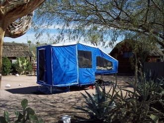 Timeout motorcycle towable pop-up style camping trailer, sleeps two people on a queensize bed.