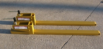 Model WOBF-2000 pair of clamp-on bucket forks with a total capacity of 2000 lbs. (1000 lbs. per fork). Overall length is 56.5 inches, useable fork length is 42 inches, tine size is 3 inches wide x 2 inches.