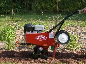 Model ST800 Suburban model Mackissic walk behind roto-tiller with 8.0 hp Briggs and Stratton engine with recoil start. Has tilling width of 26 inches and maximum tilling depth of 12 inches.