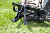 Model 525000 Loader Arm Mounted (Tractor or Skid Steer) hytdraulic tree and post puller, mounting brackets are optional.